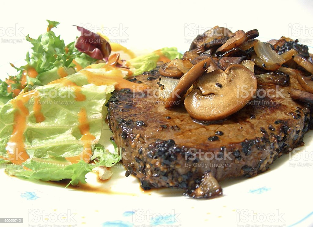 Grilled steak and mushrooms royalty-free stock photo