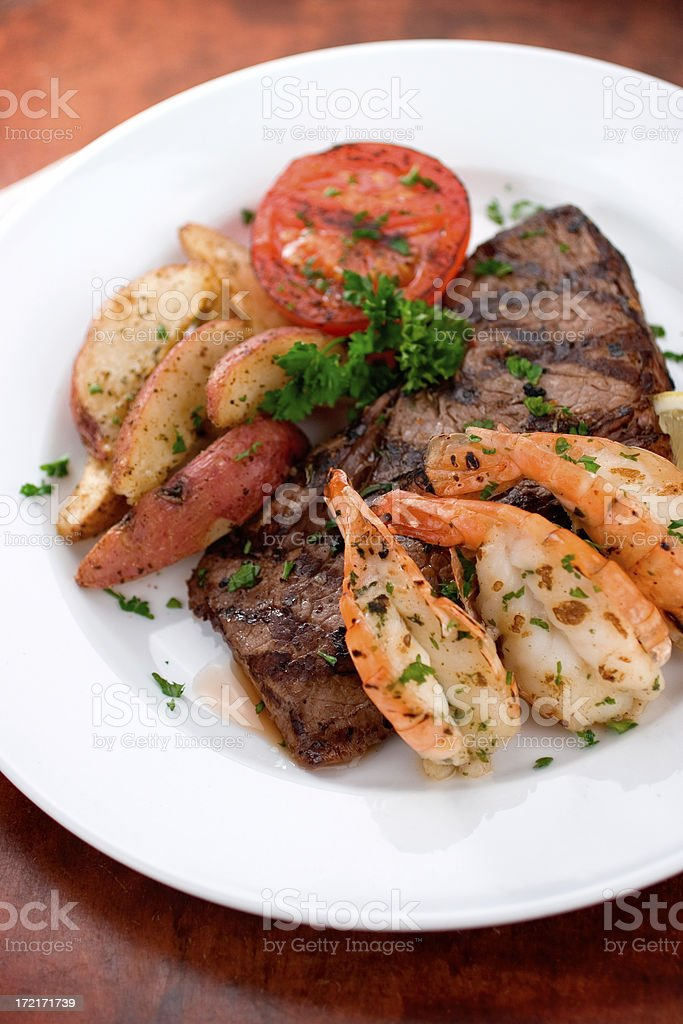 Grilled Steak and Prawns stock photo