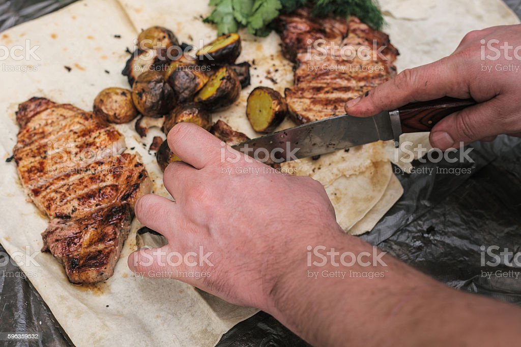 Grilled steak, bacon and potatoes lies in the pita. royalty-free stock photo