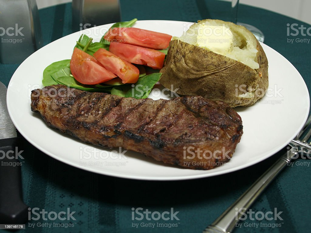 Grilled Steak dinner with utensils royalty-free stock photo