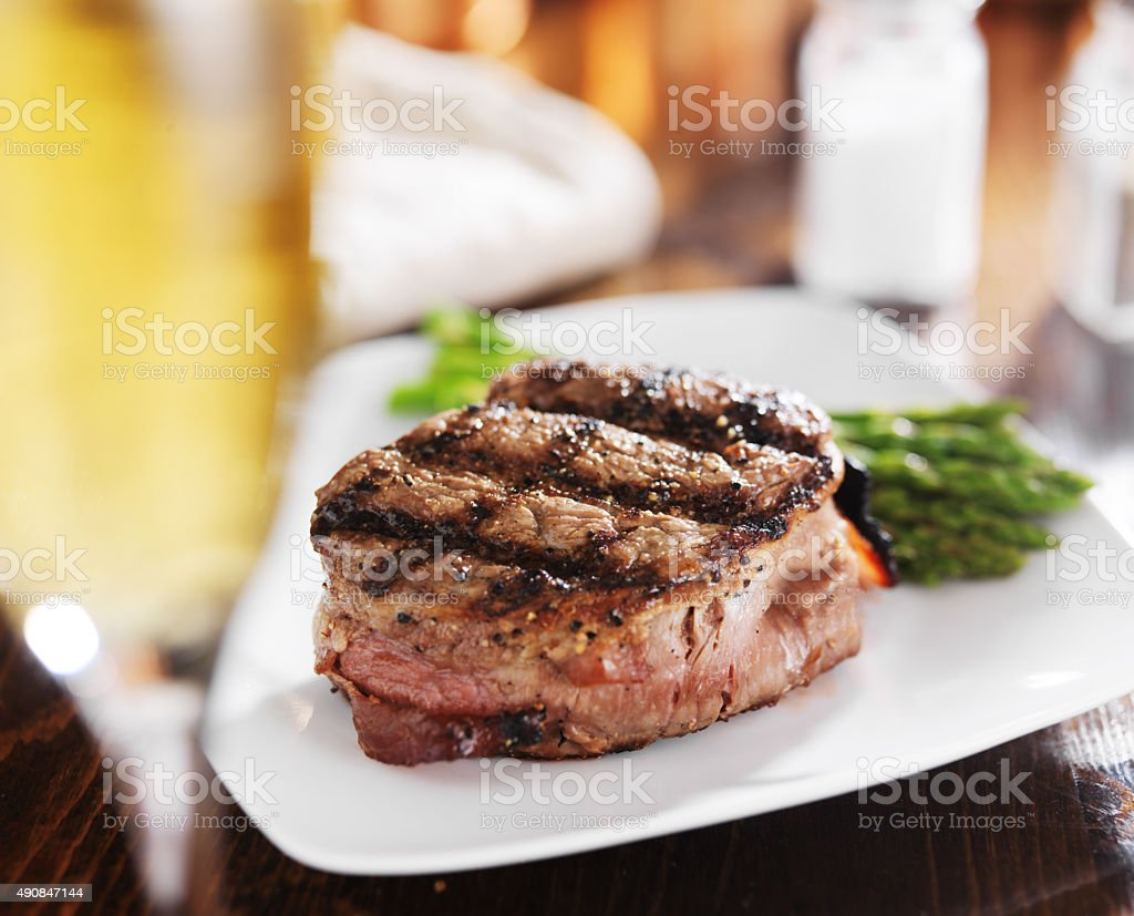 grilled steak filet with white wine and asparagus stock photo