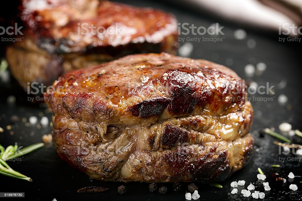 Grilled steak meat (mignon) on the dark surface stock photo