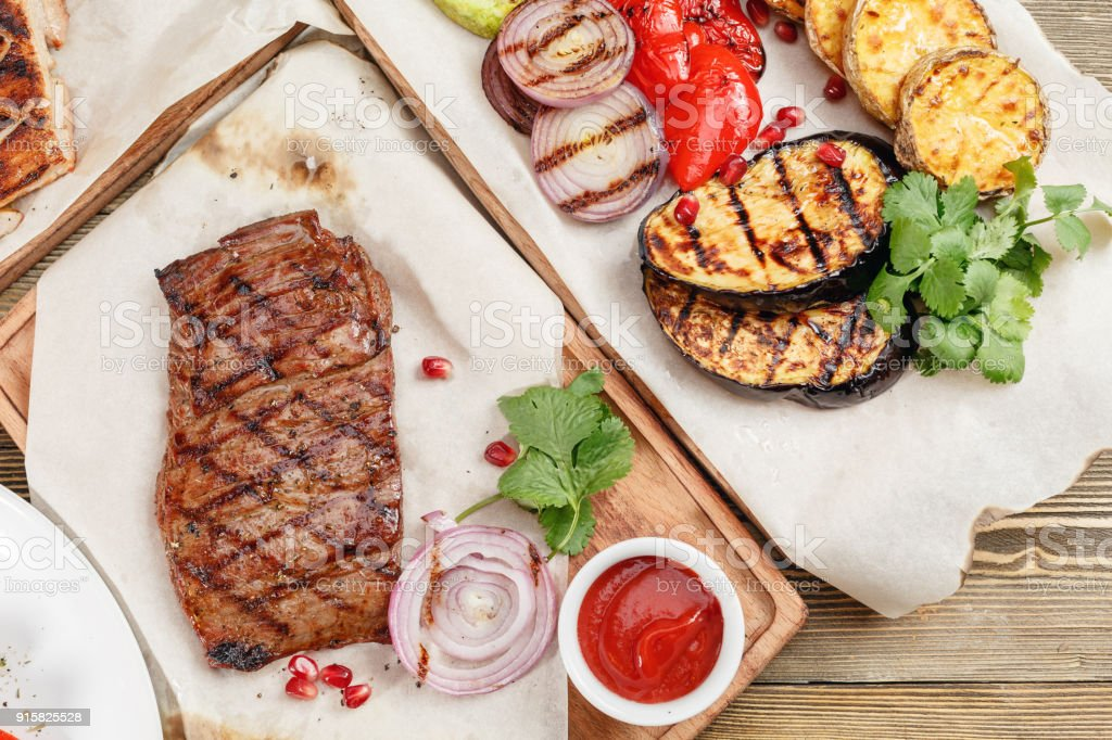 Grilled Steak Of Marble Beef Serving On A Wooden Board On A Rustic