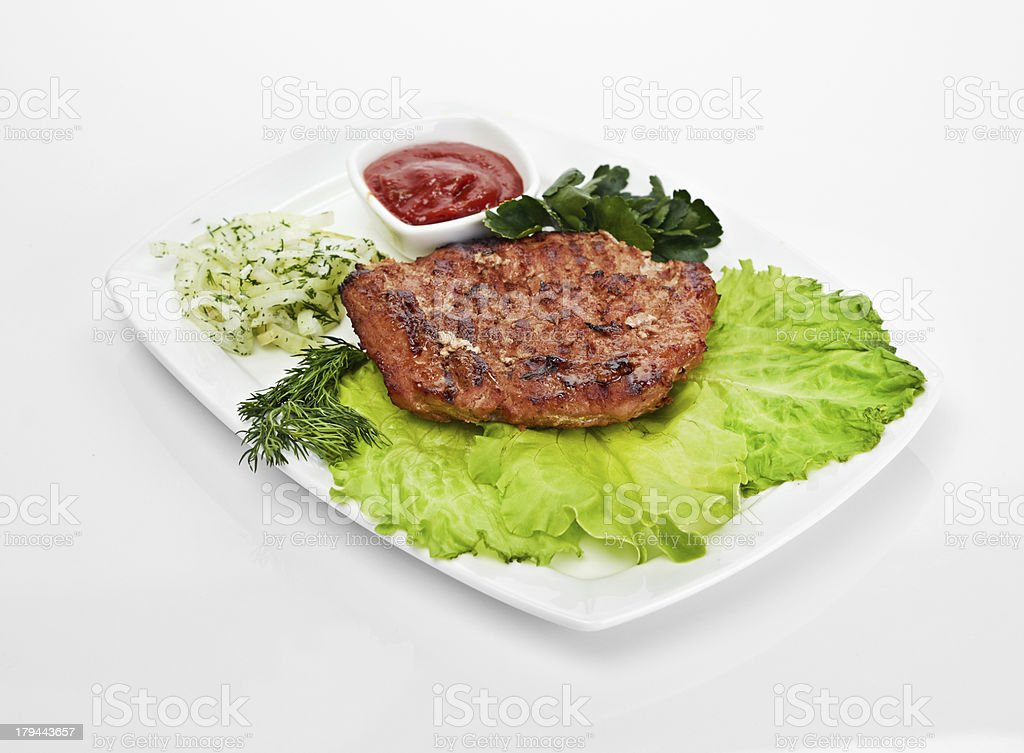 Grilled steak on a white plate royalty-free stock photo