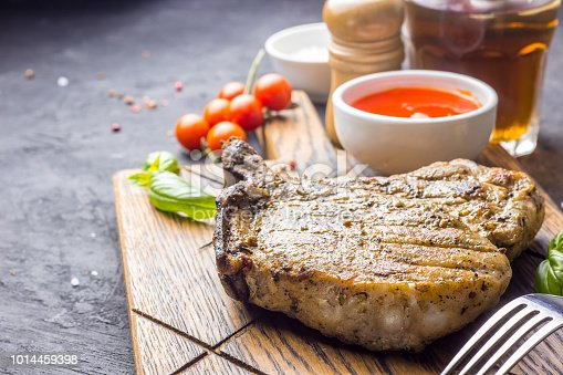 655794674istockphoto Grilled Steak on bone with knife and fork carving 1014459398
