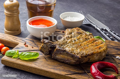 655794674istockphoto Grilled Steak on bone with knife and fork carving 1016255852