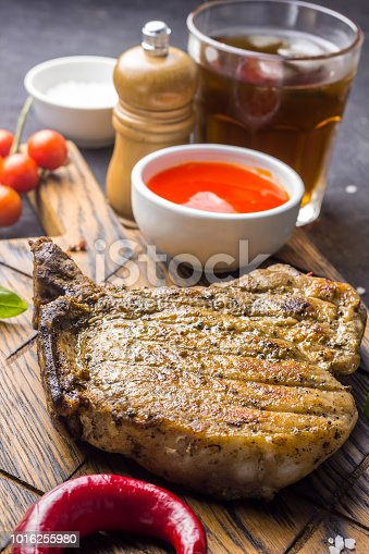 655794674istockphoto Grilled Steak on bone with knife and fork carving 1016255980