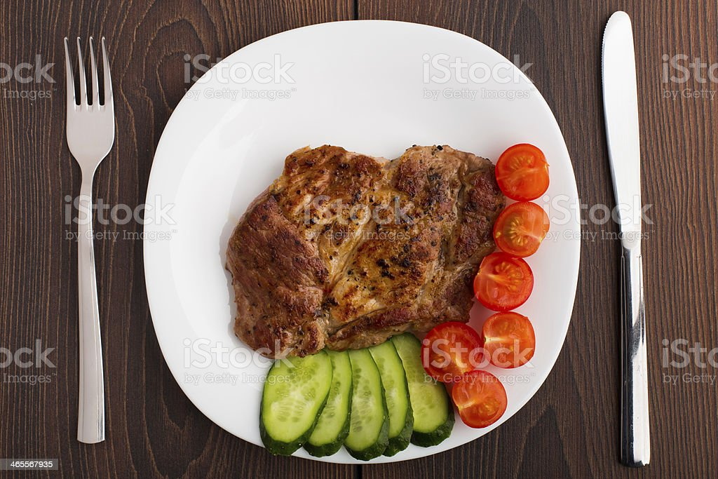 Grilled steak on white plate royalty-free stock photo