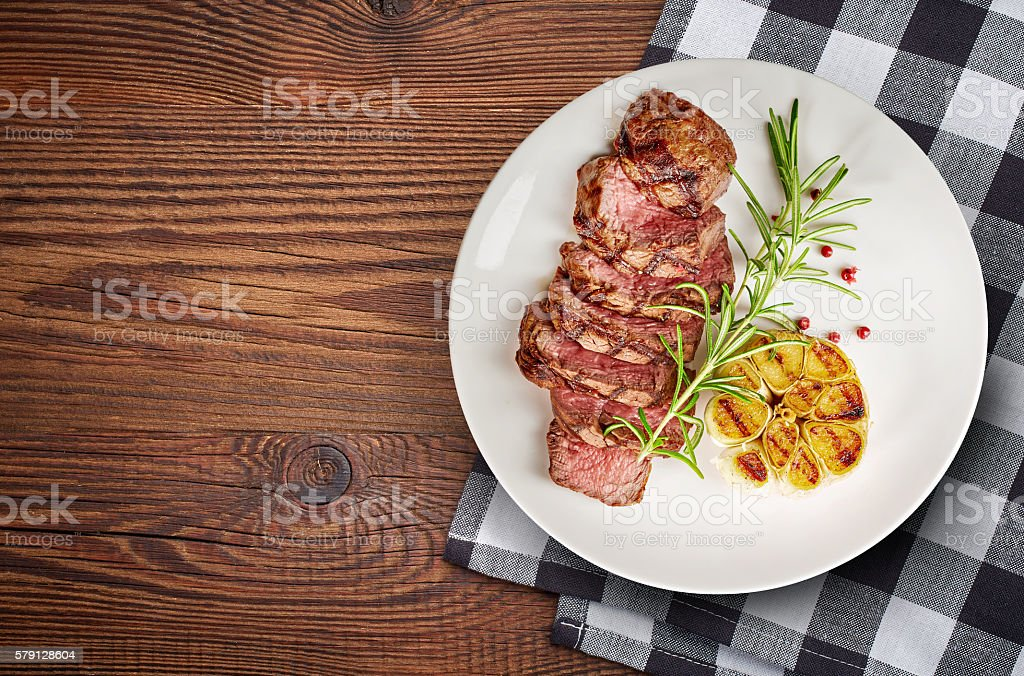grilled steak on white plate stock photo
