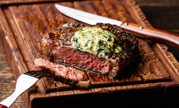 Grilled steak Rib eye with herb butter stock photo