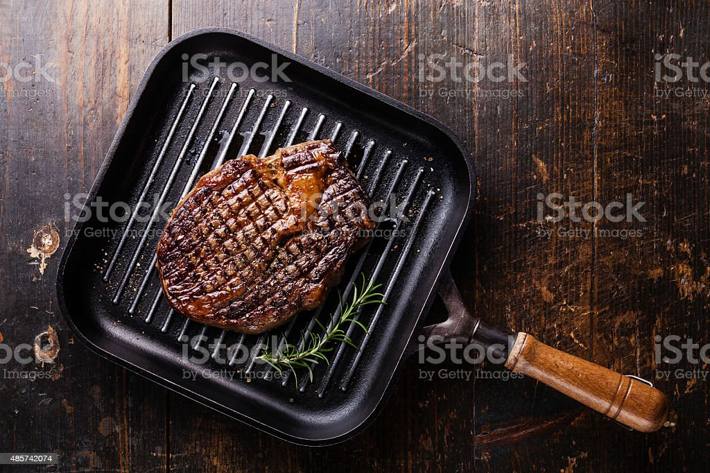 Grilled Steak Ribeye on grill pan stock photo