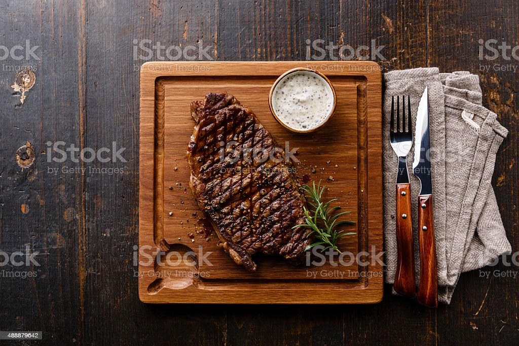Grilled Steak Striploin and Pepper sauce stock photo