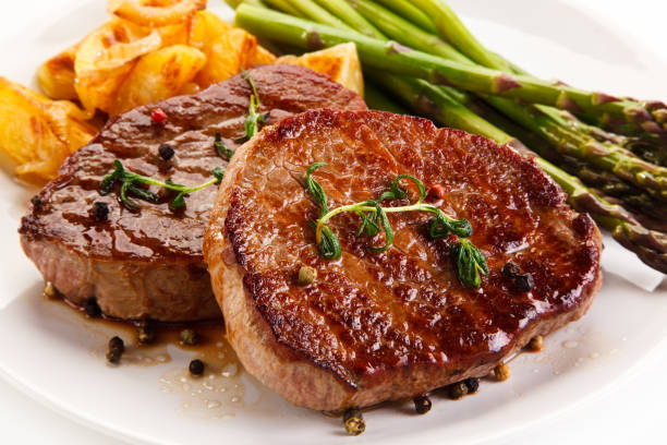 Grilled steak with asparagus Grilled steak with baked potatoes and asparagus pork stock pictures, royalty-free photos & images