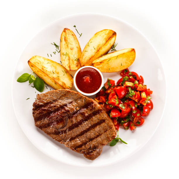 grilled steak with baked potatoes and vegetables - plate stock pictures, royalty-free photos & images