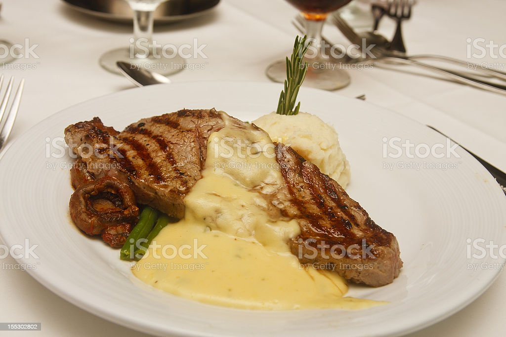 Grilled Steak with Bernaise Sauce on White Plate stock photo