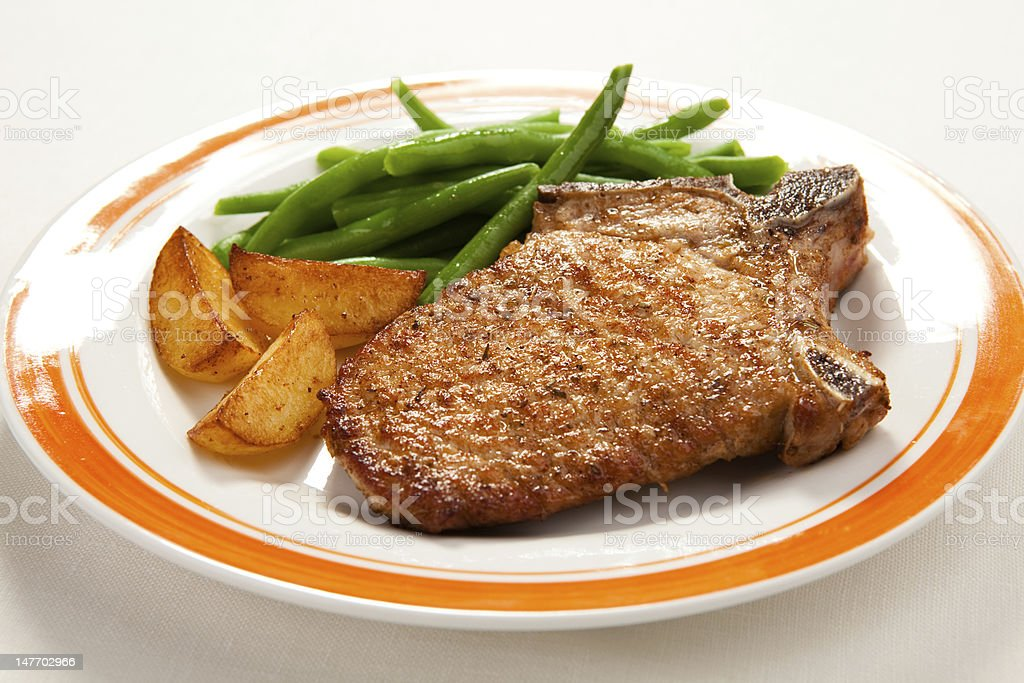 Grilled steak with chips green beans royalty-free stock photo