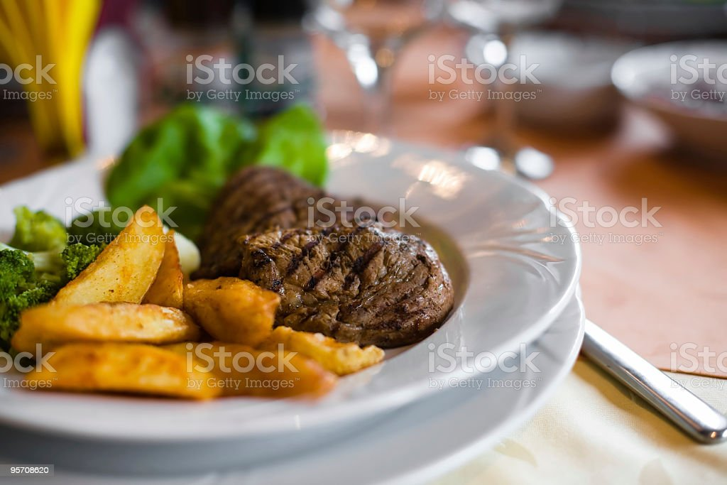 Grilled steak with french fries and broccoli royalty-free stock photo