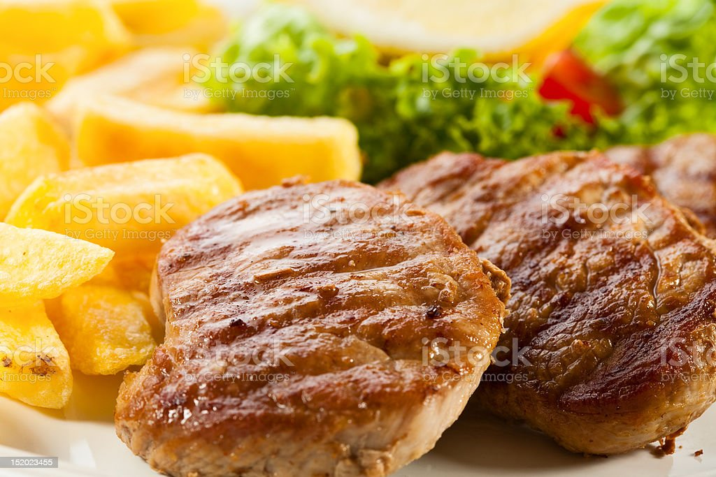 Grilled steak with French fries royalty-free stock photo