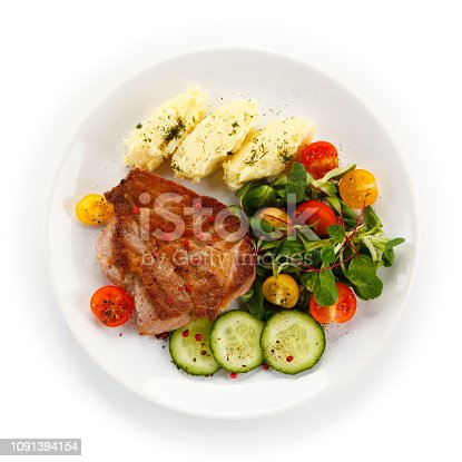 Grilled steak with mashed potatoes and vegetable salad