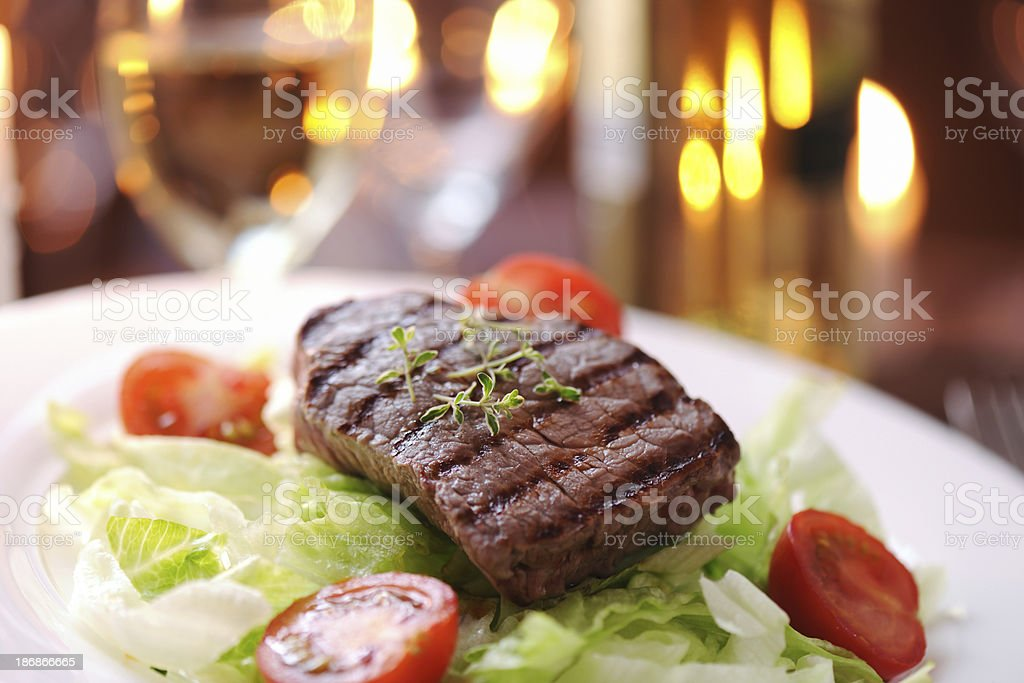 Grilled steak with salad and thyme royalty-free stock photo