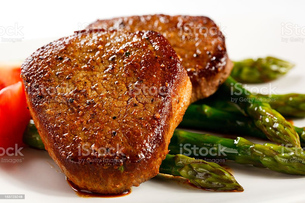 Grilled steaks and asparagus royalty-free stock photo