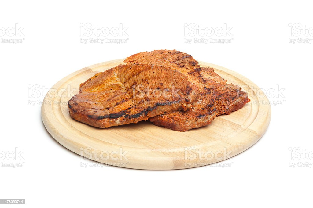 Grilled steaks on chopping board stock photo