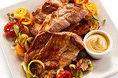 Grilled steaks with vegetable salad