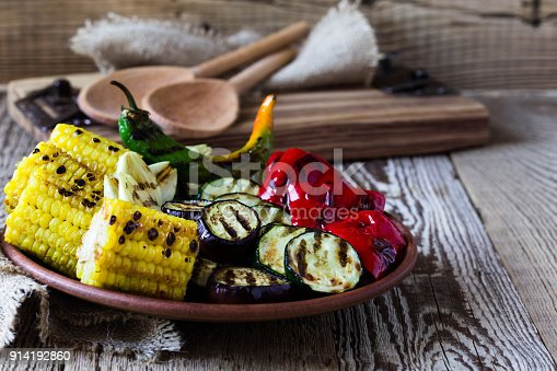 655793486 istock photo Grilled summer vegetables on rustic table 914192860