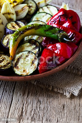 655793486 istock photo Grilled summer vegetables on rustic table 914192940
