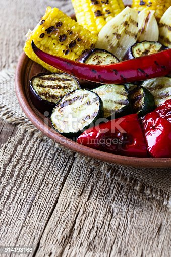 655793486 istock photo Grilled summer vegetables on rustic table 914193168