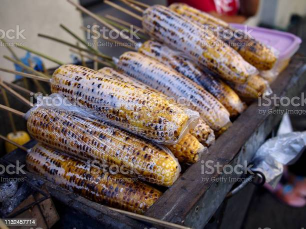 Grilled sweet corn on barbecue stick sold at a street food cart picture id1132457714?b=1&k=6&m=1132457714&s=612x612&h=bbfwzpqc5odvvtqlv cjcjncisdtiukxsigbpeffd8u=