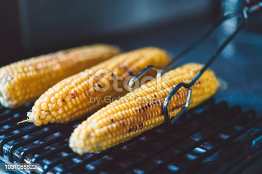 Grilling the corn on a barbecue grill, summer grilling, corn on the cob, food is life, summer picnic food is the best.