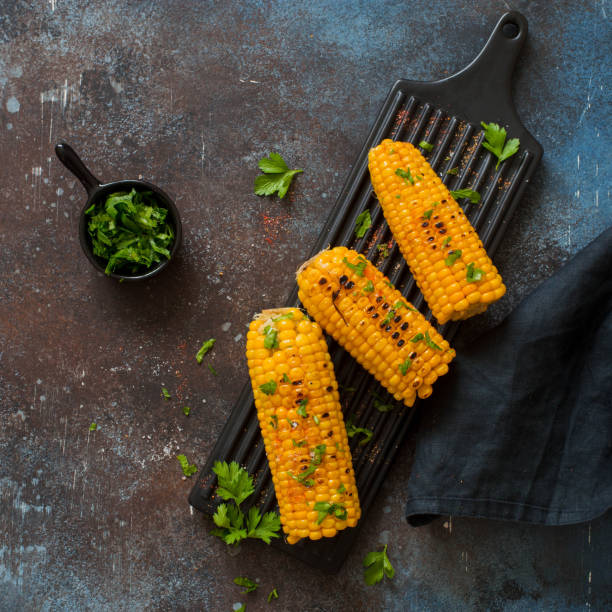 Grilled sweet corn with spices stock photo