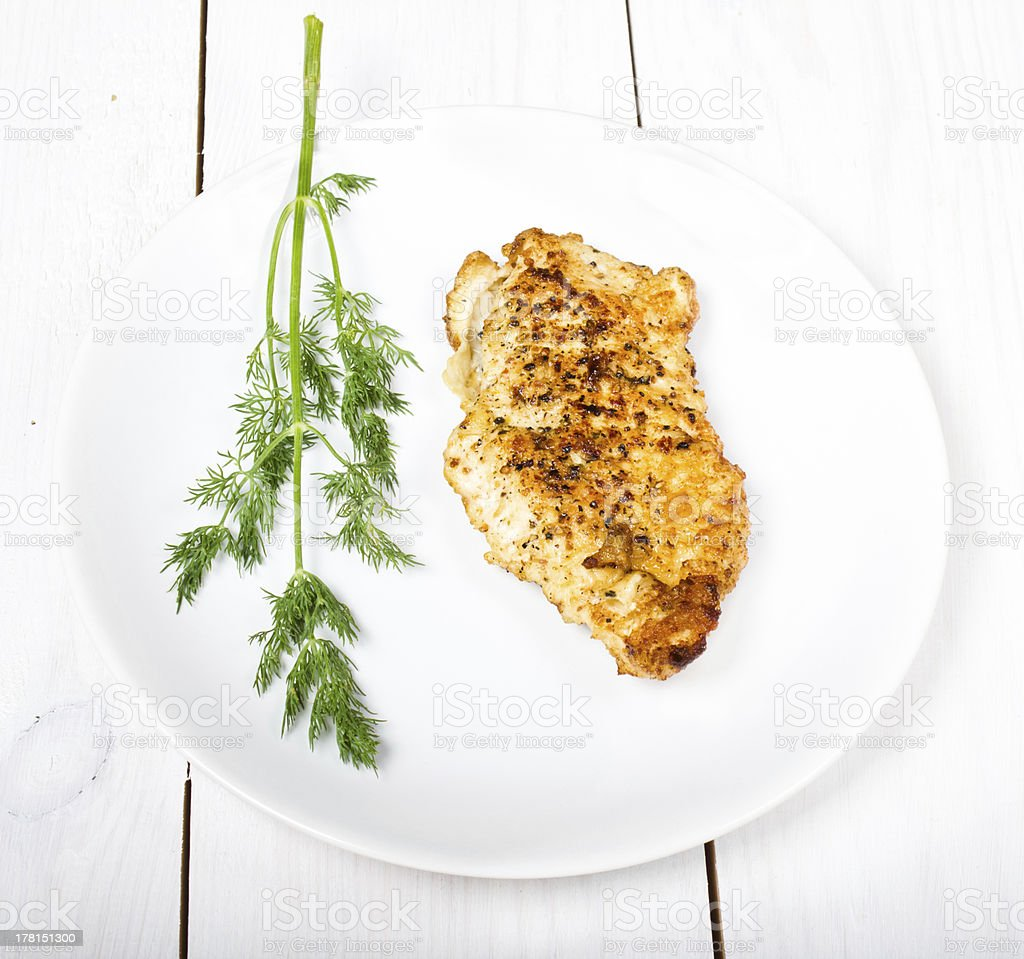 Grilled tasty chicken breasts on a white plate royalty-free stock photo
