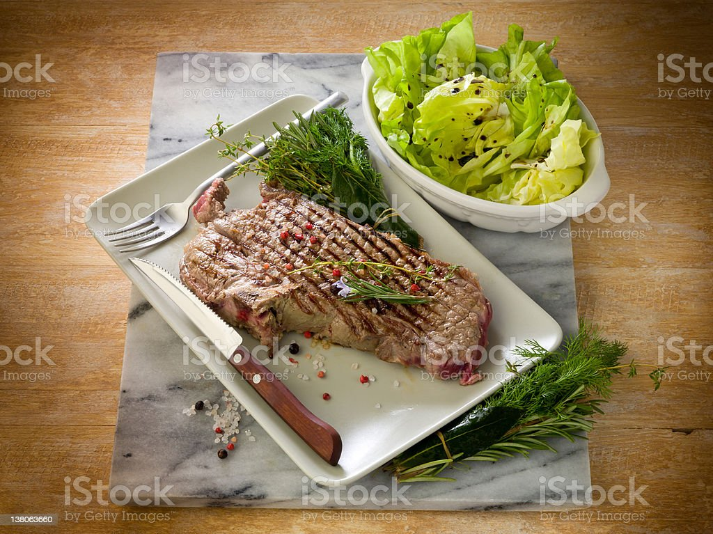grilled t-bone with green salad royalty-free stock photo