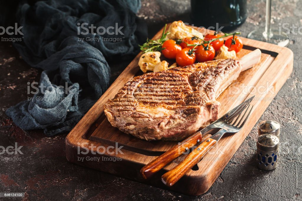 grilled tomahawk beef steak stock photo