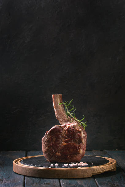 grilled tomahawk steak - beef angus imagens e fotografias de stock