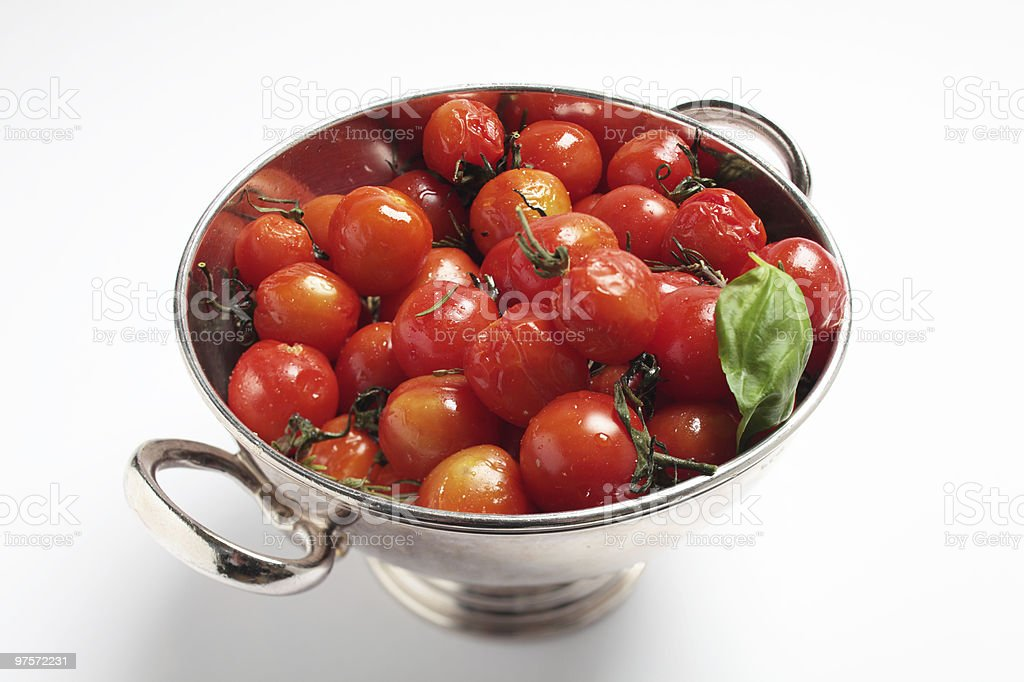 Grilled tomatoes in silverbowl royalty-free stock photo