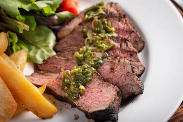 grilled tri tip steak with green onion sauce stock photo