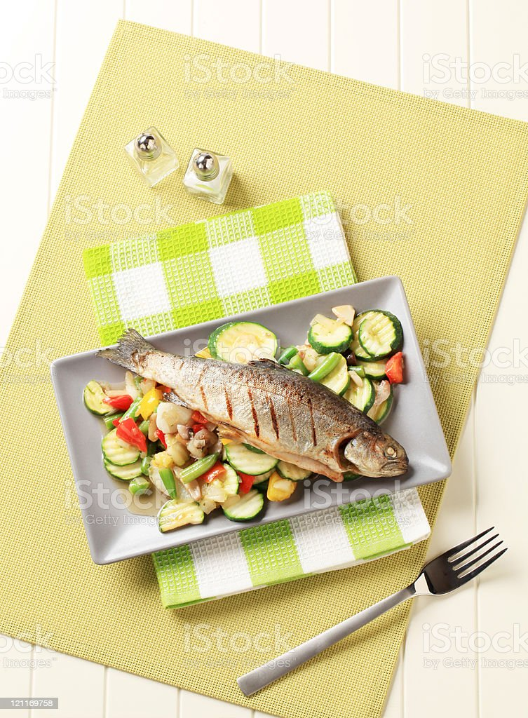 Grilled trout and mixed vegetables royalty-free stock photo