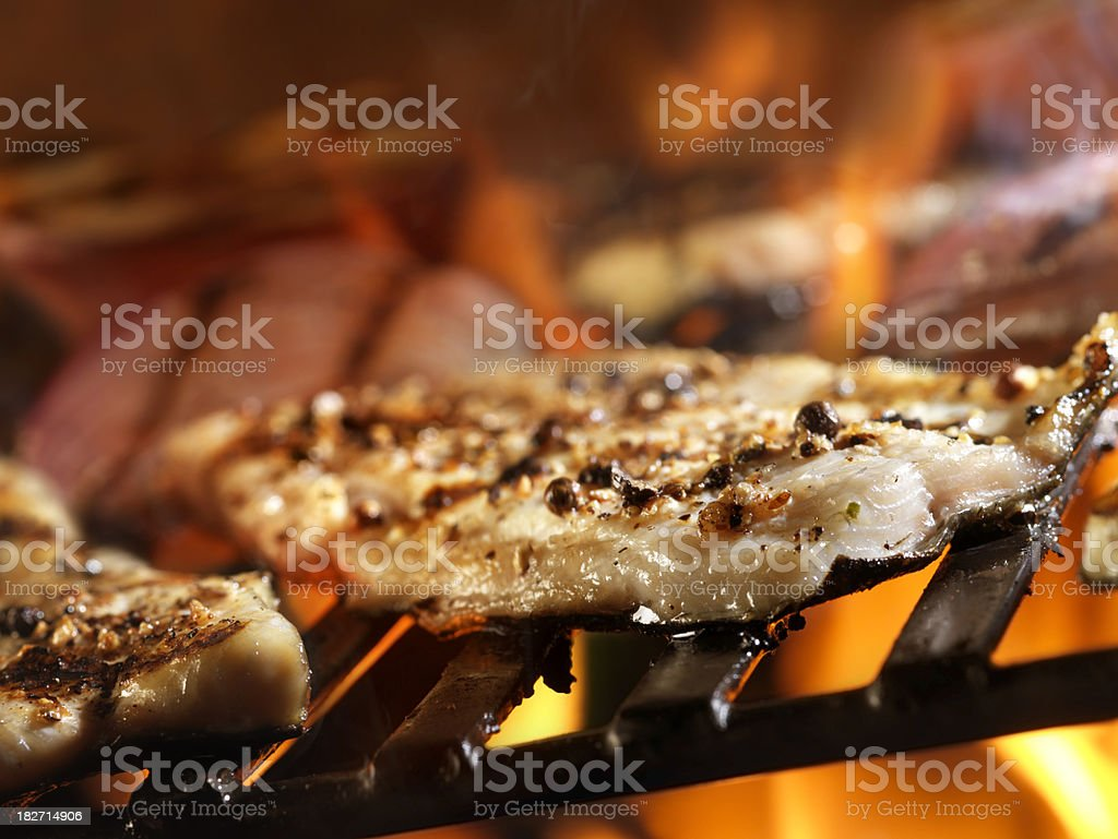 Grilled Trout on the BBQ royalty-free stock photo