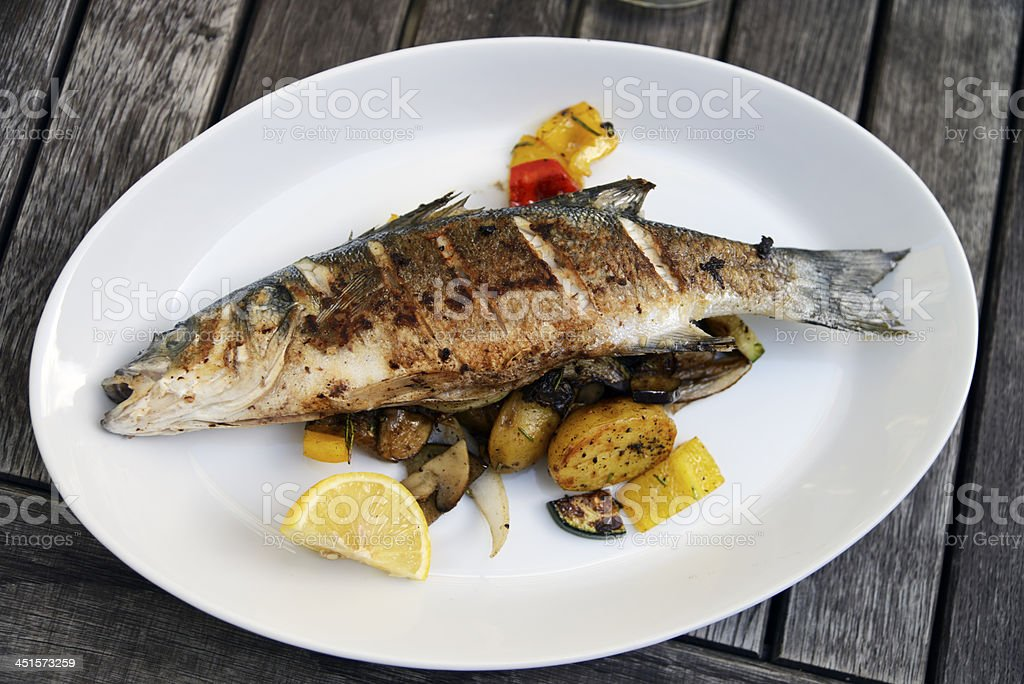 Grilled trout served in Czech restaurant royalty-free stock photo