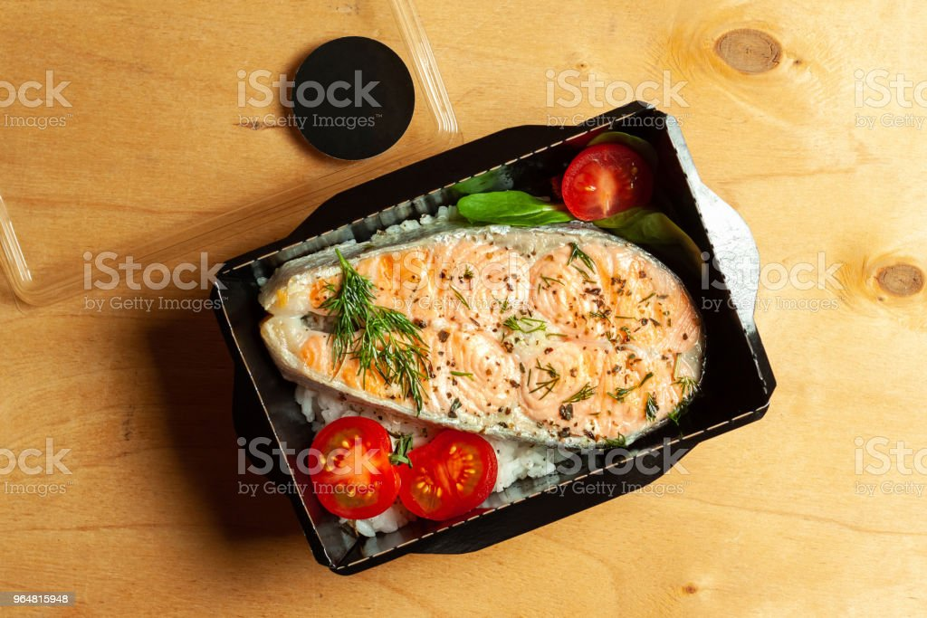 Grilled trout with rice and cherry tomatoes royalty-free stock photo