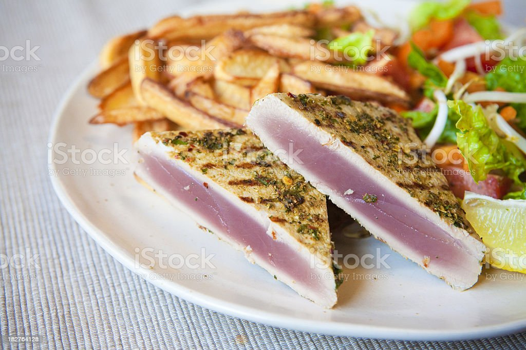 grilled tuna and fries royalty-free stock photo