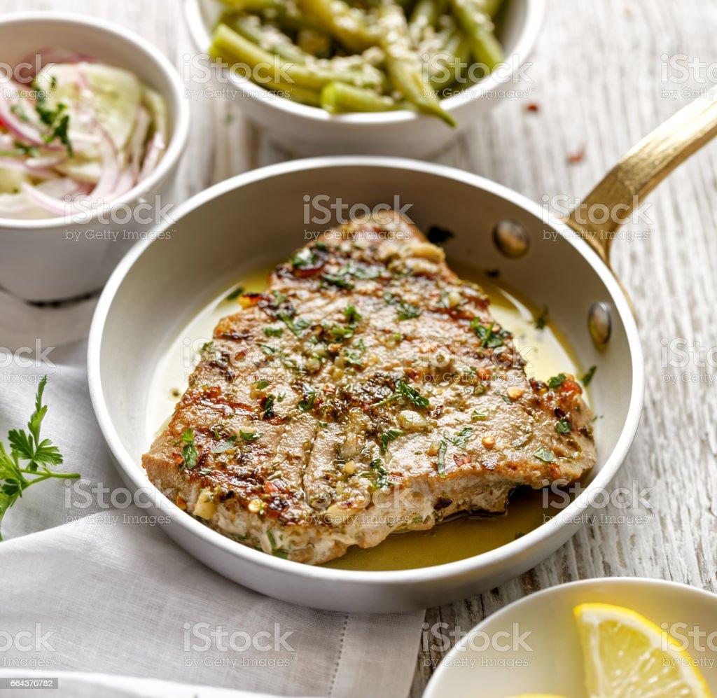 Grilled tuna steak in herb and lemon marinade stock photo