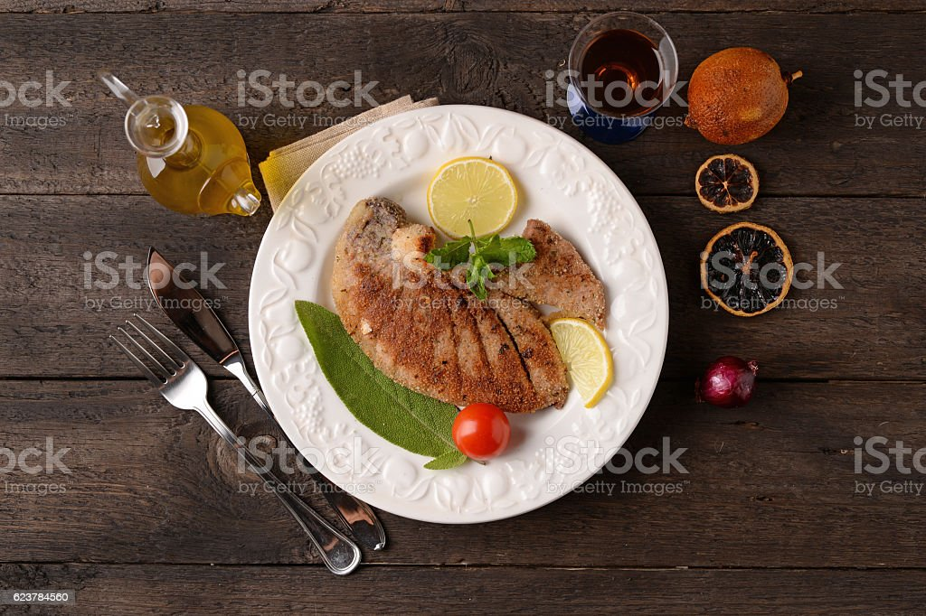 Grilled tuna steak on a white plate stock photo