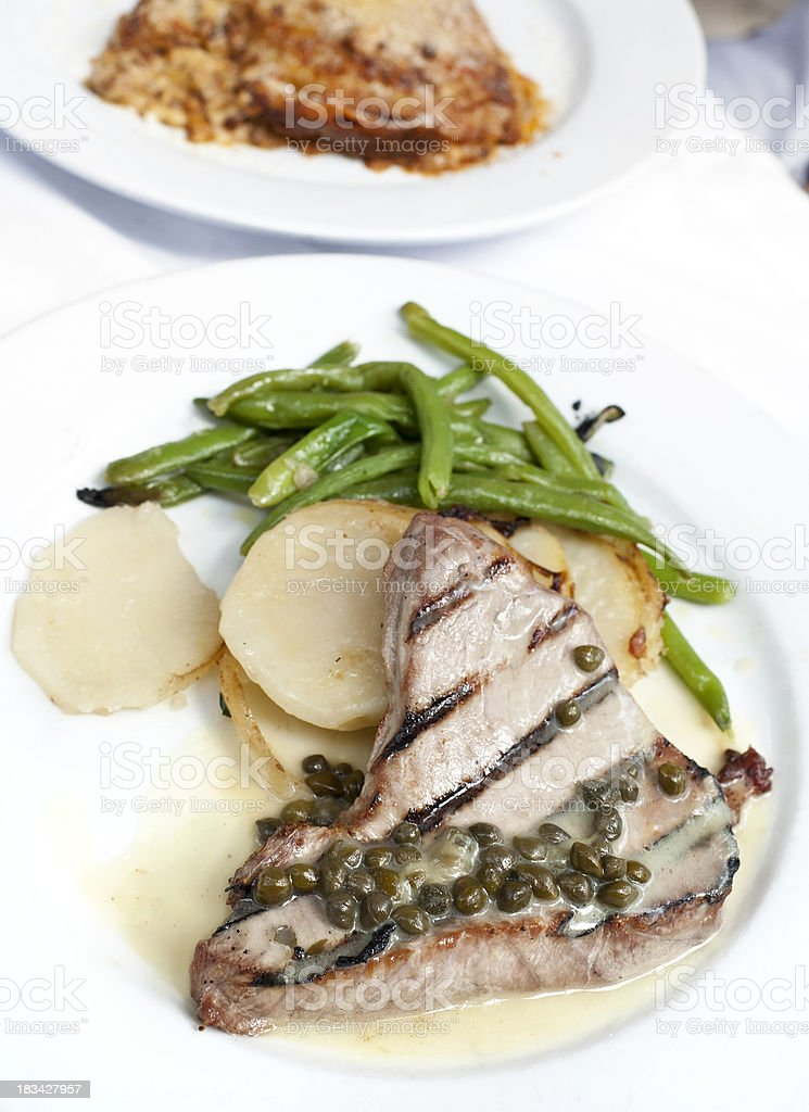 Grilled Tuna Steak with Capers Sauce stock photo