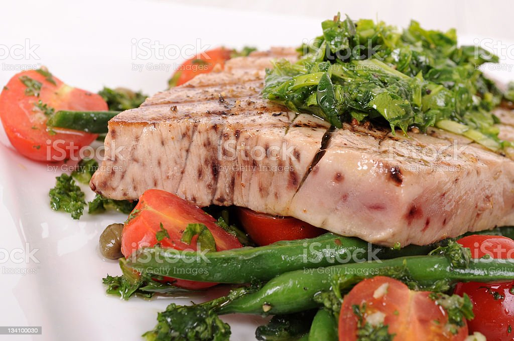 Grilled tuna steak with vegetables royalty-free stock photo