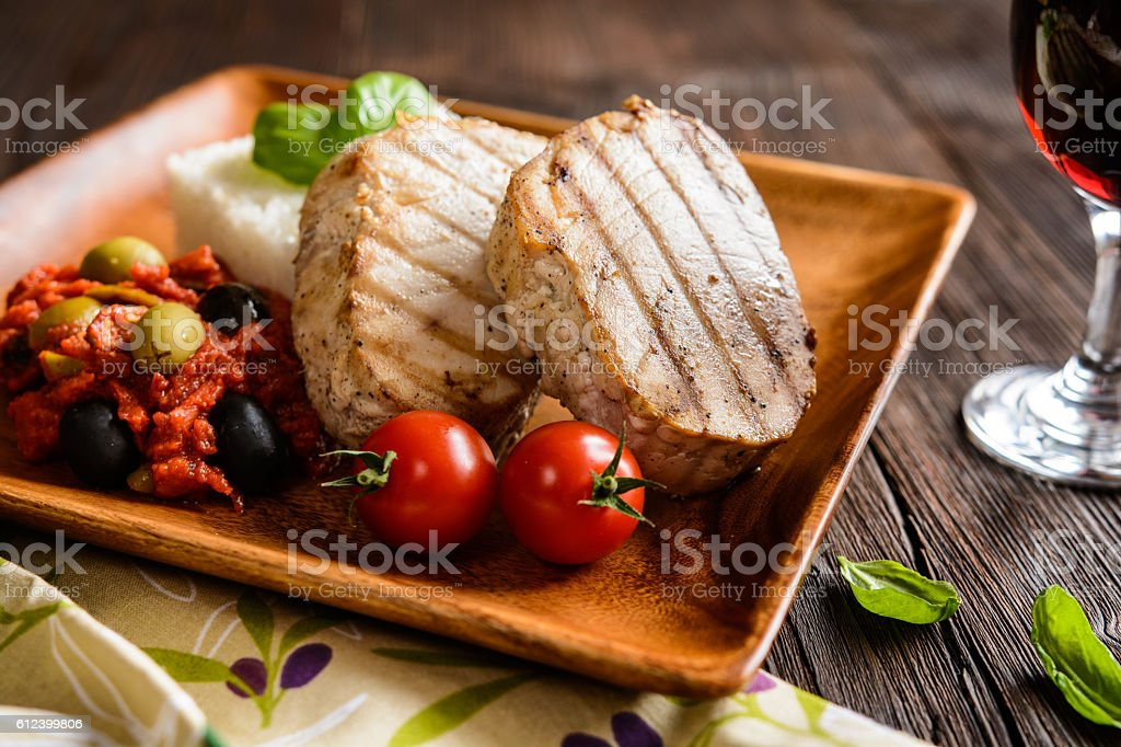 Grilled tuna steaks with rice and tomato sauce stock photo