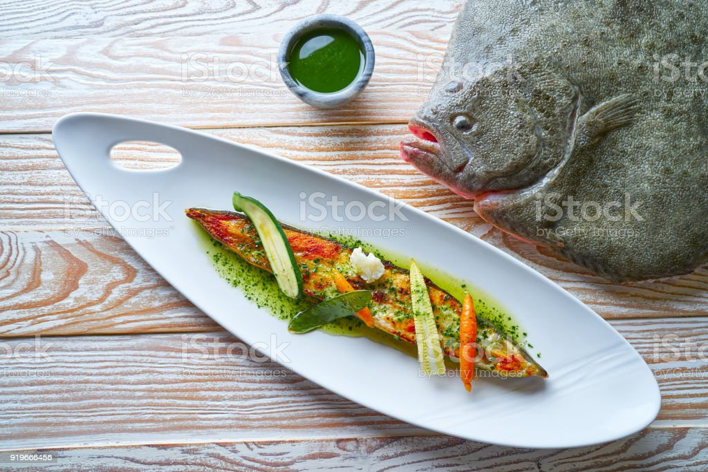 Grilled turbot over wild asparagus stock photo